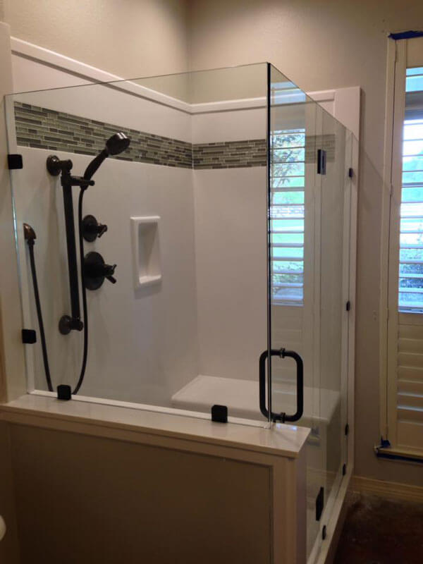 shower with glass walls and moveable head